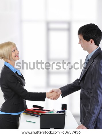 Handshake two business partners in a bright office. - stock photo