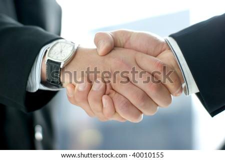 Handshake (Warning! Low depth of field!) - stock photo