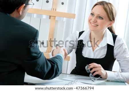 handshake while job interviewing - stock photo