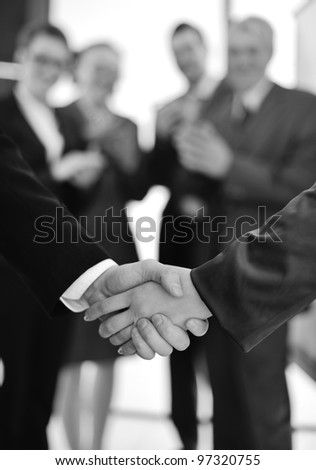 handshake with business people applauding - stock photo