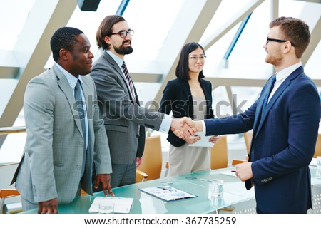 Handshaking after negotiation - stock photo