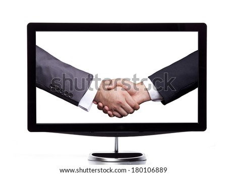 Handshaking on the screen - stock photo
