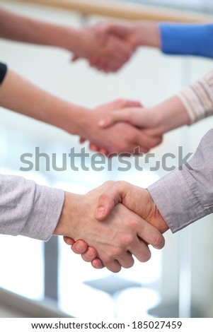 Handshaking partners. Photo of tree pairs of partners arms handshaking after striking deal