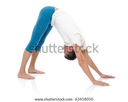Handsome active man doing yoga fitness poses. isolated on white background - stock photo