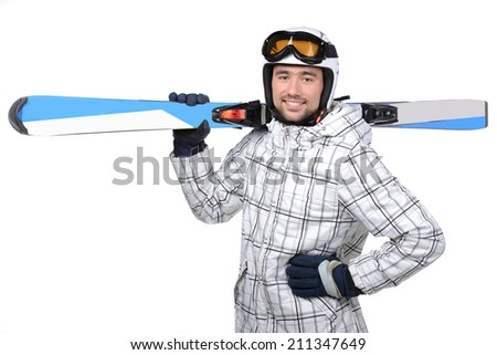Handsome active man with sky in ski suit. Standing full length isolated over white background - stock photo