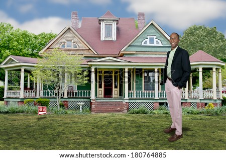 Handsome African American adult man realtor selling a house - stock photo