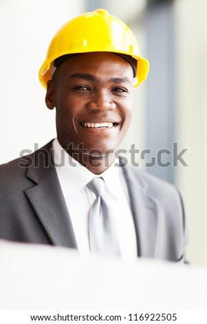 handsome african american architect with construction plan