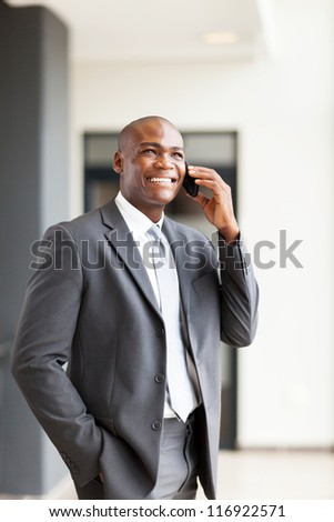 handsome african american business executive talking on cellphone - stock photo