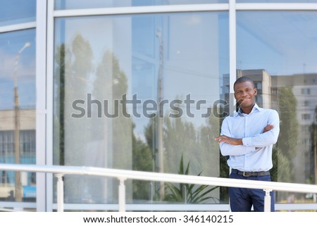Handsome African American businessman near business centre - stock photo