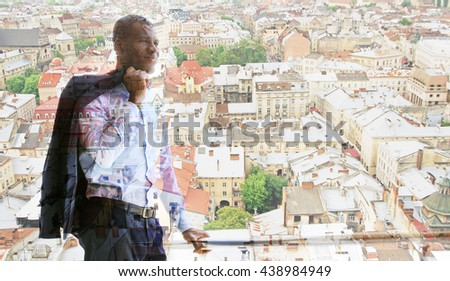 Handsome African American businessman on city transparent background - stock photo