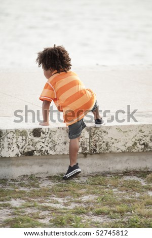 Handsome African American child in the outdoors - stock photo