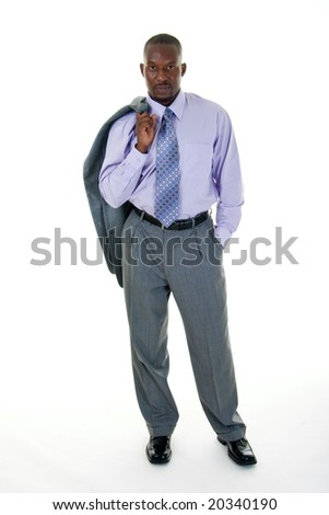 Handsome African American man in a gray business suit with the coat tossed over his shoulder for a more casual look. - stock photo