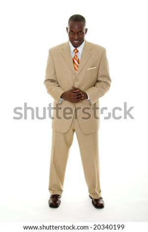 Handsome African American man in a tan business suit with a direct, smiling forward facing expression. - stock photo
