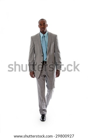 Handsome African American man in gray suit with smile walking, isolated - stock photo