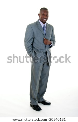 Handsome African American man standing in a gray business suit. - stock photo