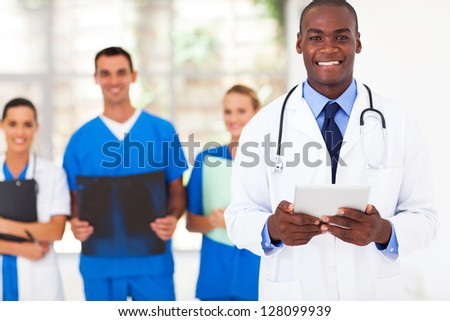 handsome african american medical doctor and team - stock photo