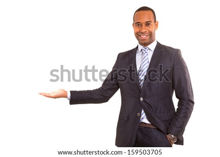 Handsome african business man presenting your product - stock photo
