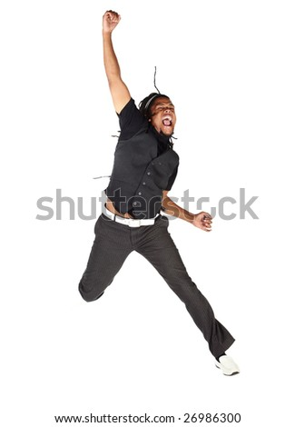 Handsome African businessman in black suit jumping from joy on white background. Not isolated