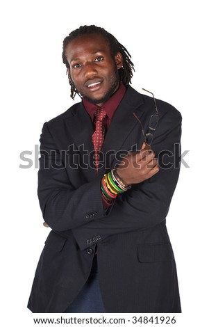 Handsome African businessman with glasses in black suit on white background.