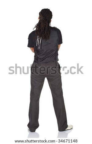 Handsome African businessman with long hair in black informal suit on white background. NOT ISOLATED - stock photo