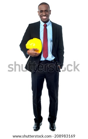 Handsome african engineer with hard hat, hand in pocket - stock photo