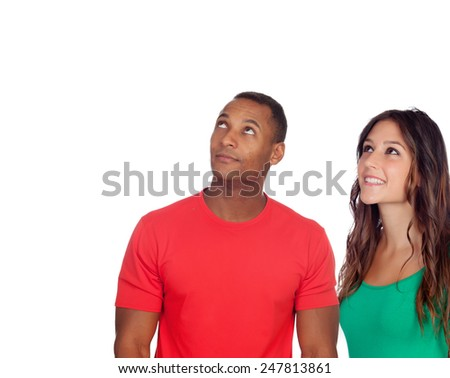 Handsome african guy and his caucasian girl looking up isolated on a white background - stock photo
