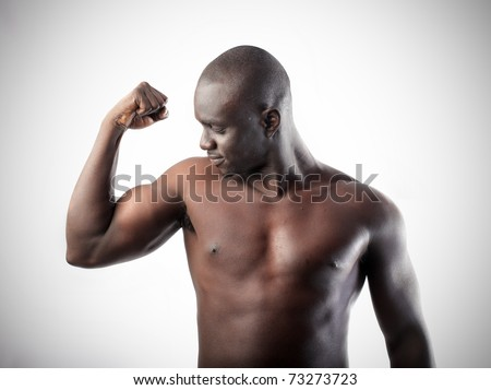Handsome african man showing his biceps - stock photo
