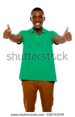 Handsome african showing double thumbs up against white background