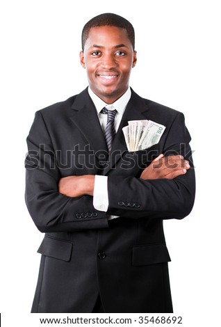 Handsome Afro-American businessman with folded arms and dollars in a pocket - stock photo