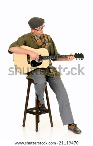 Handsome alternative dressed music performer, guitar player.  Studio, white background