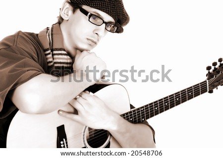 Handsome alternative dressed music performer, guitar player.  Studio, white background, high key