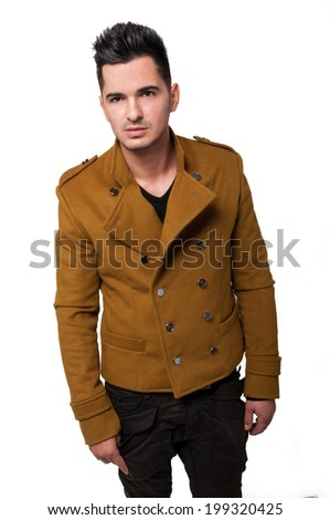 Handsome and fashionable male model wearing a fancy jacket on a  white background