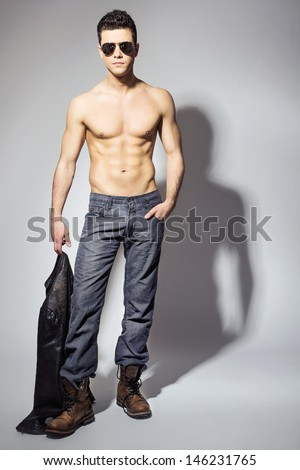 Handsome and irresistible young man - stock photo