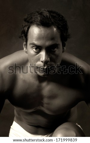 Handsome and muscular man in boxer shorts in a dark background - stock photo