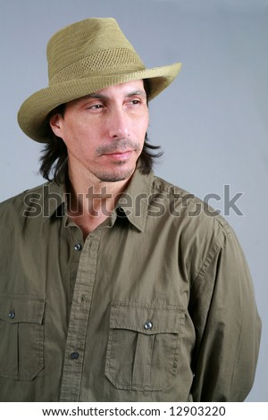handsome and rugged man in straw hat - stock photoHandsome Rugged Man