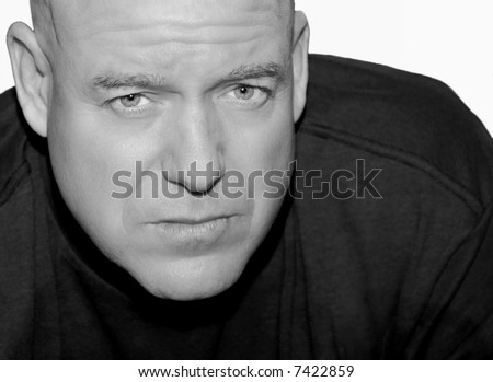 Handsome and Rugged Middle Aged Man with Serious Expression - stock photo
