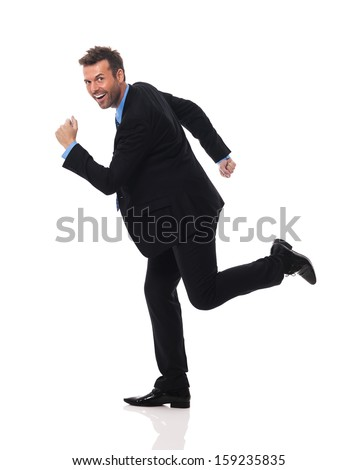 Handsome and smiling businessman hurry up  - stock photo