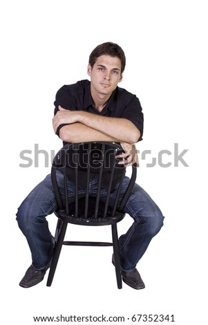 Handsome and stylish model sitting on chair - Isolated - stock photo