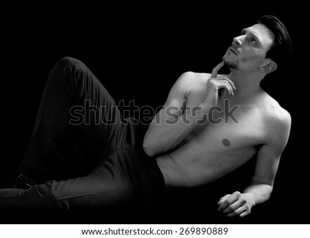 Handsome and thoughtful bare-chested man portrait black and white - stock photo