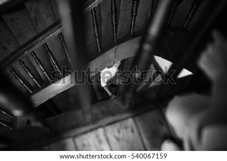 handsome and young man coming down the wooden stairs