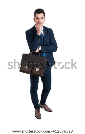 Handsome and young salesman standing isolated on white background elegant and holding a briefcase