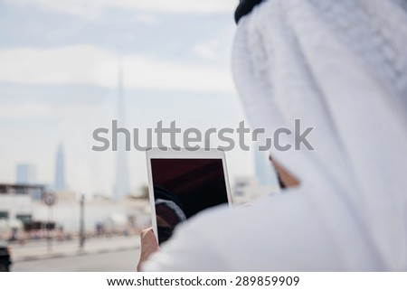 Handsome Arabian Businessman Using Digital Tablet Outdoors. - stock photo