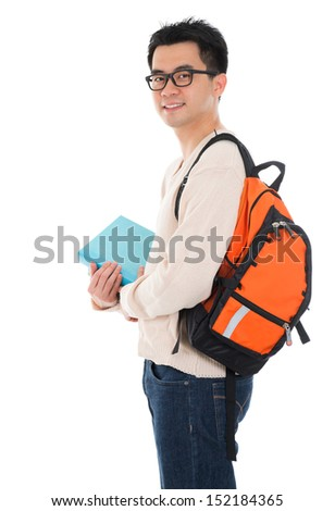 Handsome Asian adult student in casual wear with school bag carrying text books standing isolated on white background. Asian male model. - stock photo