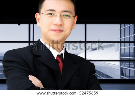 Handsome asian business man in suit at an airport - stock photo