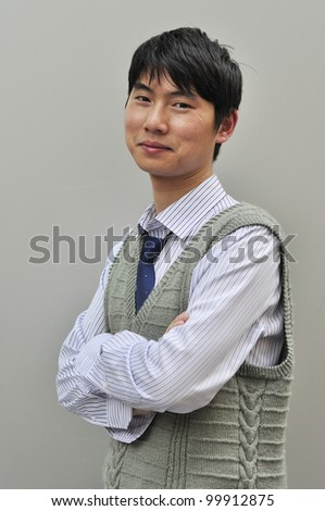 handsome asian businessman is smiling - stock photo