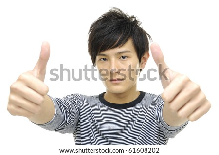 Handsome asian young man with thumb up isolated
