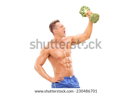 Handsome athlete lifting a broccoli dumbbell isolated on white background - stock photo