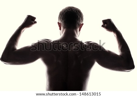 Handsome athlete on a white background