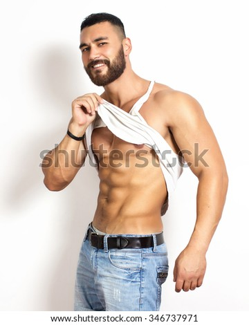 handsome athlete poses.studio shot - stock photo