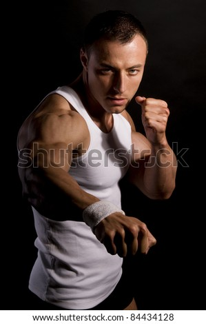 Handsome athlete with muscular body - stock photo